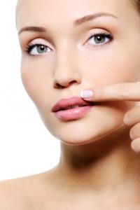 beauty female with finger near her lips